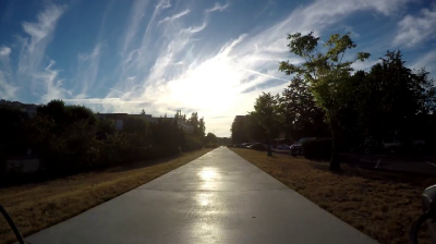 Video of a path outside while the sun shines brightly.